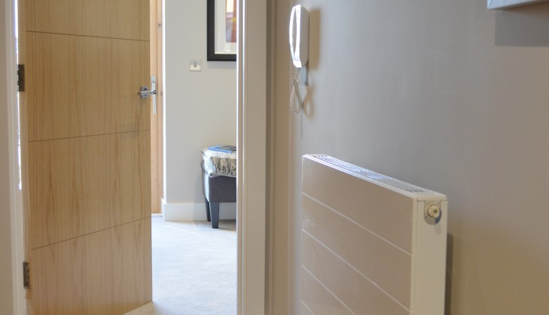A Stelrad Compact with Style radiator in the hallway of one of the homes.