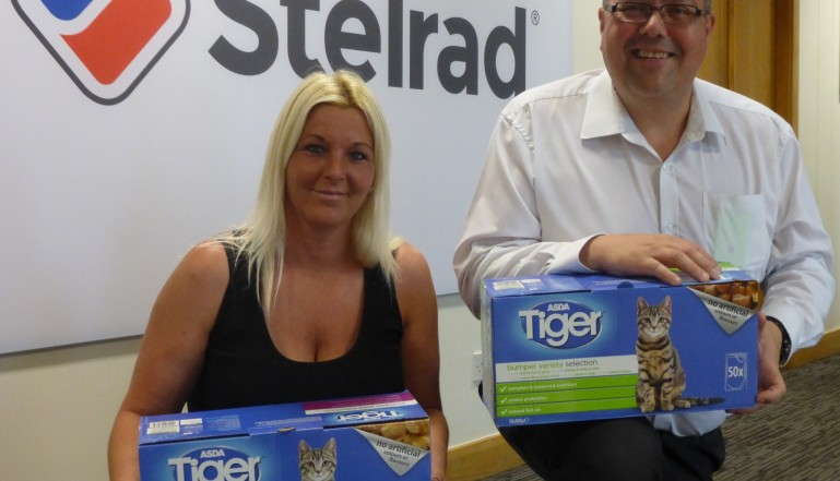 BARC's Kerry Flood collects the donations from Neil Land at Stelrad recently