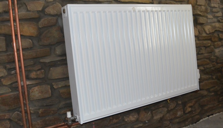 A Stelrad radiator against a beautiful Dartmoor stone interior wall in the new part of the centre