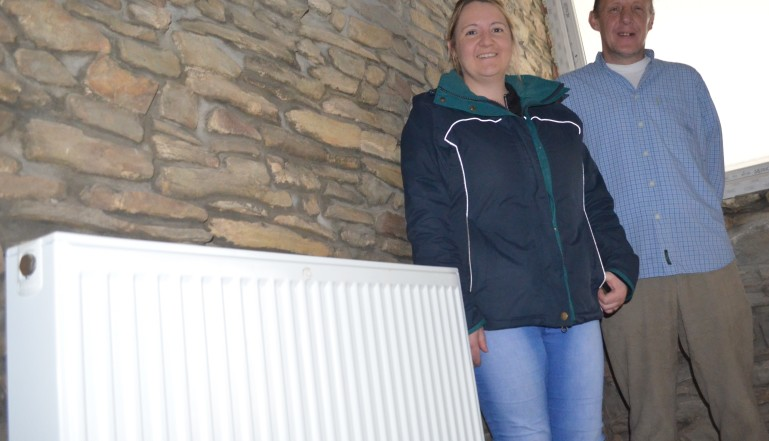 Lois Samuel from Gilead with Ed Boast and one of the radiators donated by Stelrad