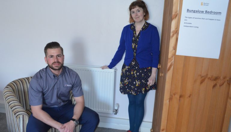 Stelrad's Joel Cumberbatch with one of the specialists at Burton Street seeing the 'bungalow' for himself.