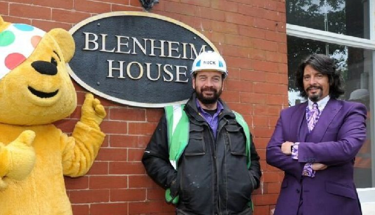 Nick Knowles with Laurence Llewellyn-Bowen and Pudsey outside the latest DIY SOS project in Blackpool.