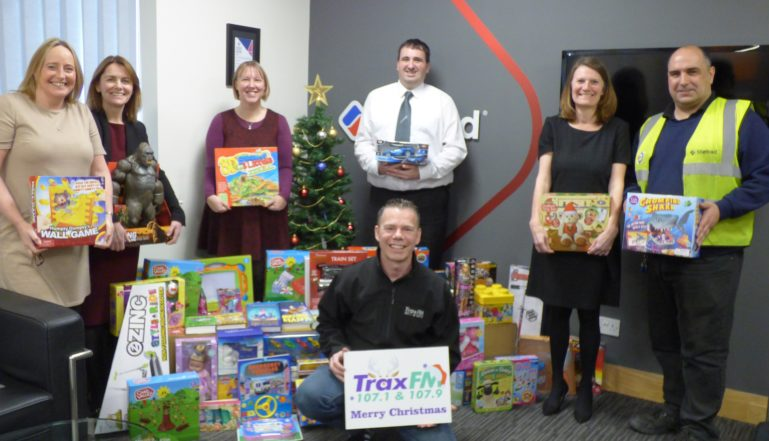 Members of the Stelrad team with the presents collected for localchildren