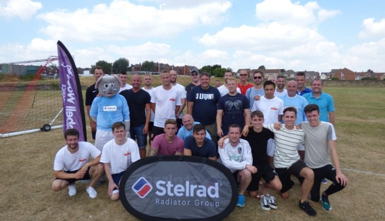 Both teams and supporters at the charity football match
