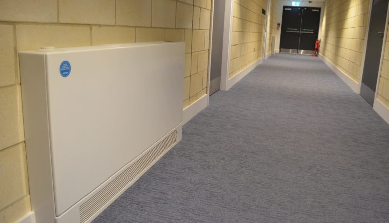 One of the Stelrad LST radiators in a corridor in the centre.