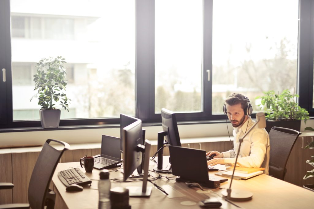 Man working in office with headset on