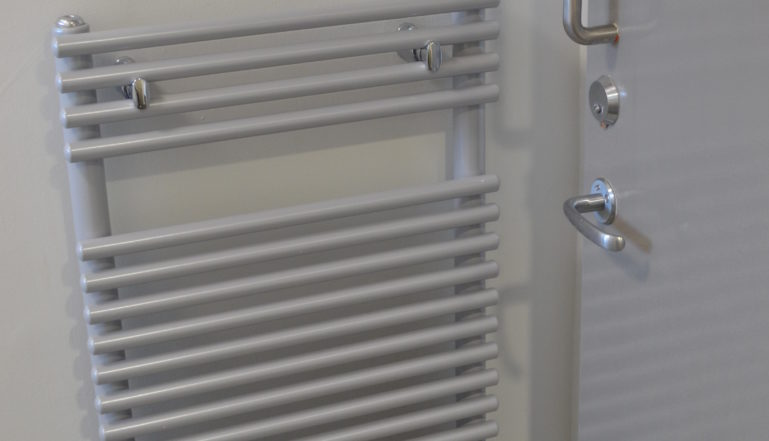 One of the new Caliente radiators in the shower rooms and toilets.