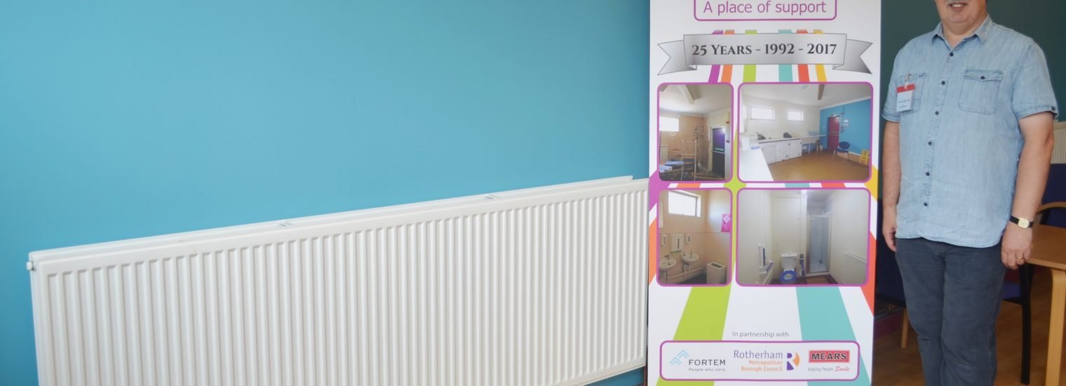 Shiloh Centre Manager Kevin Quinton with one of the new radiators in the dining room at Shiloh